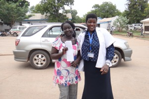 Angelina, ANC HIV counsellor, and Lucia, JCONAM nursing tutor, after supervising JCONAM students' clinical practice