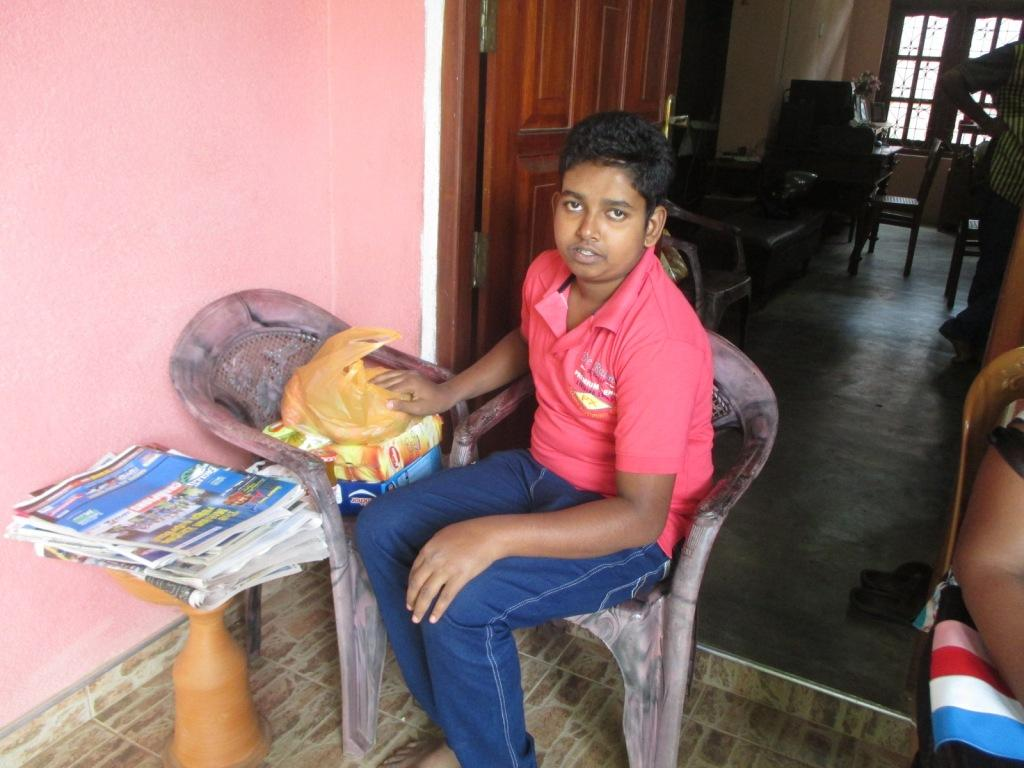 Gayan with the food parcel