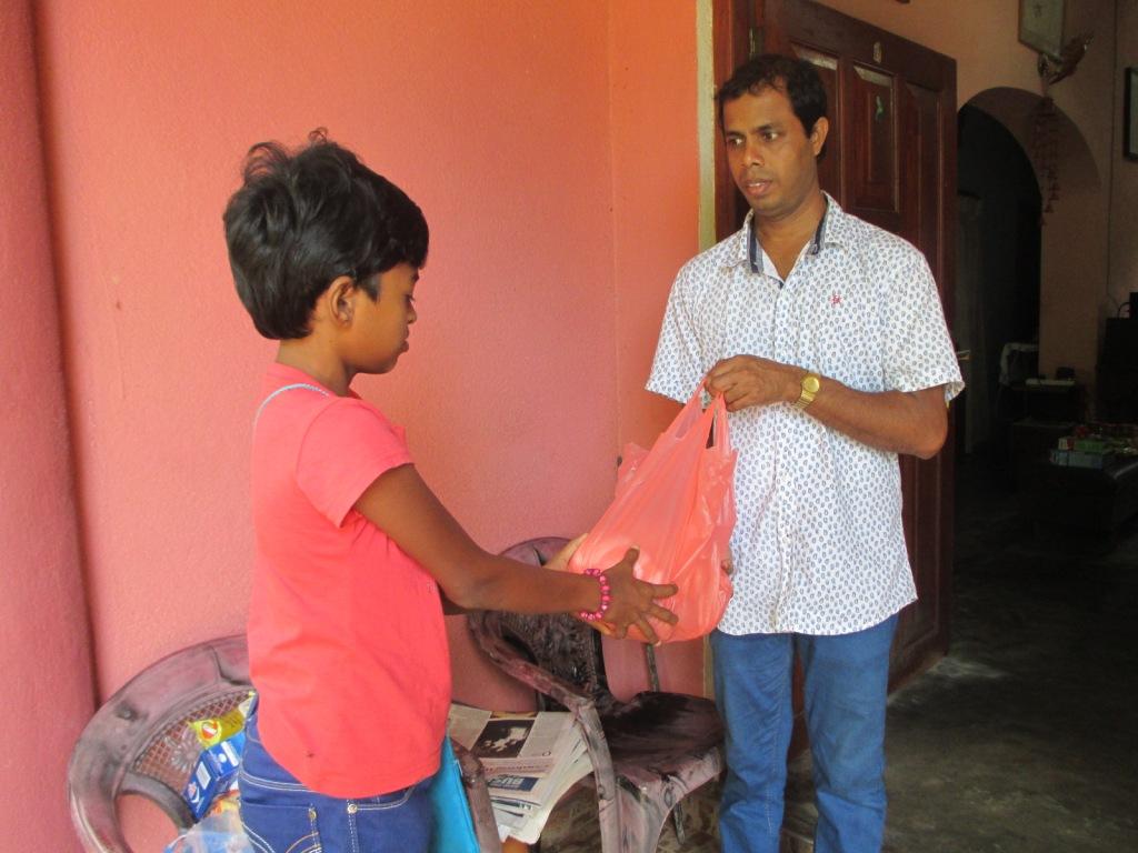 Nishantha gives the food parcel to Madu