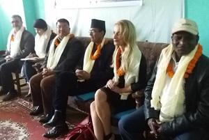 nepali meeting handing over supplies