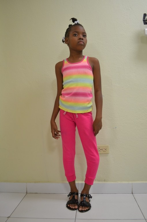 young girl with leg deformities in haiti