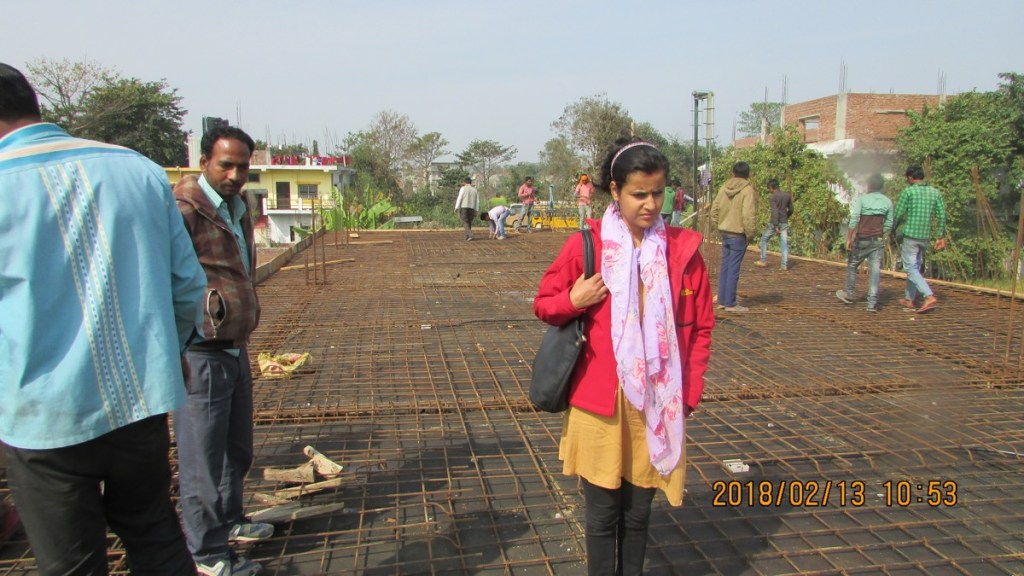 RMF Nepal Program and M&E Coordinator inspecting the roof before concrete is poured