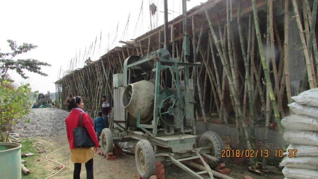 RMF Nepal Program and M&E Coordinator inspecting the construction process