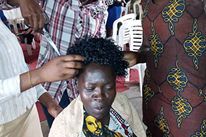 Woman receiving a haircut