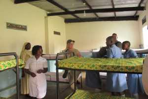 WCF team members, Tim and Cathy, visiting the school sick bay. They were welcomed by the school nurse and Sister Martha and observed the daily activities at the sick bay.