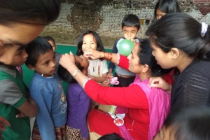 RMF Nurse Bina giving Vitamin A capsules to NCO children between 6 months and 5 years of age