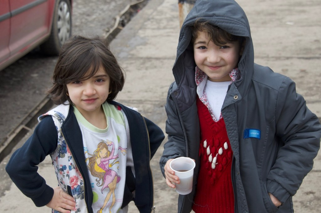Two young girls in front of Miksalište Refugee Aid Centre, Belgrade