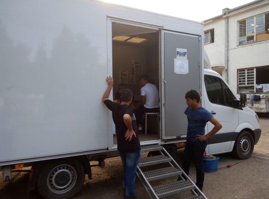 Patients in front of RMF's mobile clinic, Obrenovac Camp