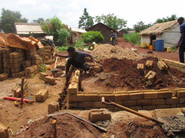 Sunday Kodra constructing a shelter at Kiryandongo Refugee Settlement