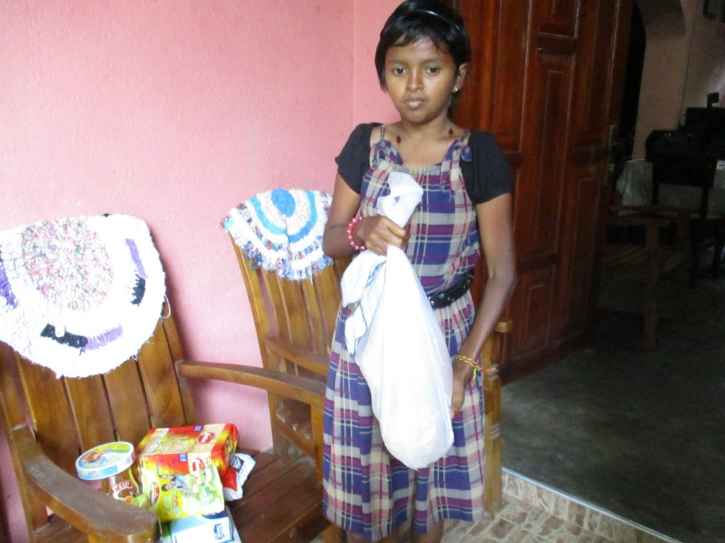 Madumekala receives the food parcel