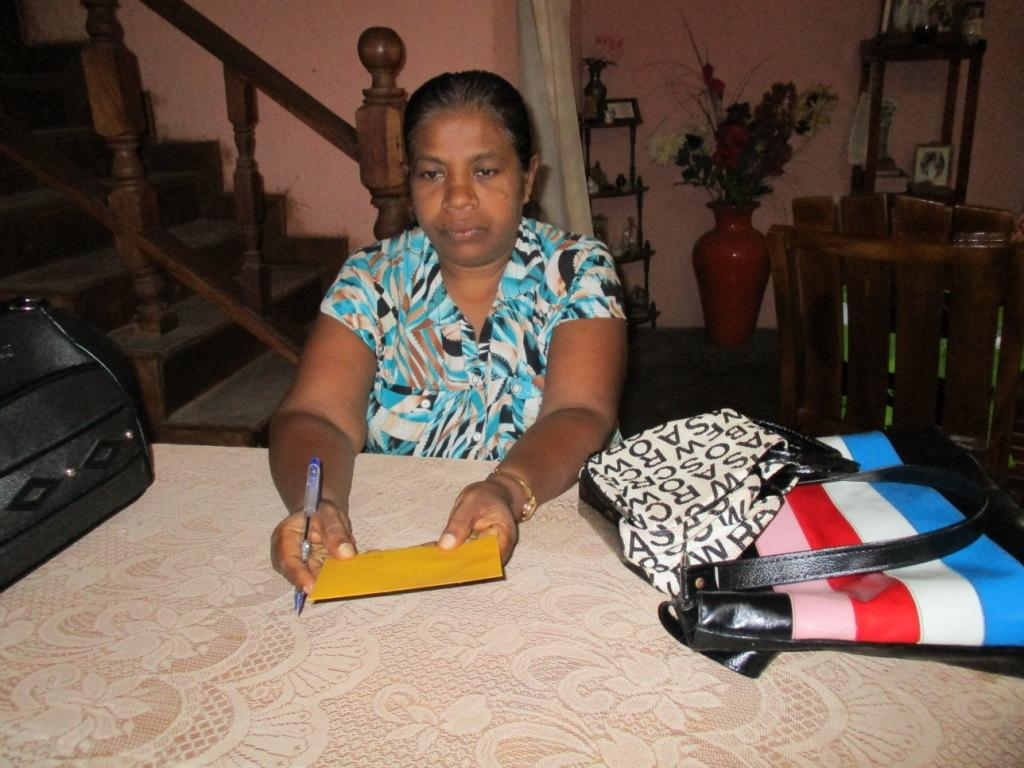 Madura's mother receives the travel fee