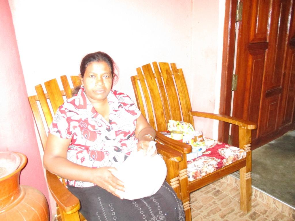 Madura's mother with the food parcel