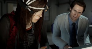 Jodie (Ellen Page) and Nathan (William Dafoe) running through an experiment.