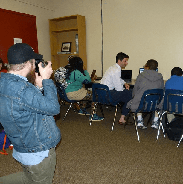 Andy Lee takes photos of The #WrensNest Scribes and Mentors during their weekly writing workshop at KIPP Strive Academy. The Scribes are in 5th through 8th grades and when they finish their stories they will publish them in a book to be launched at the #DecaturBookFestival.