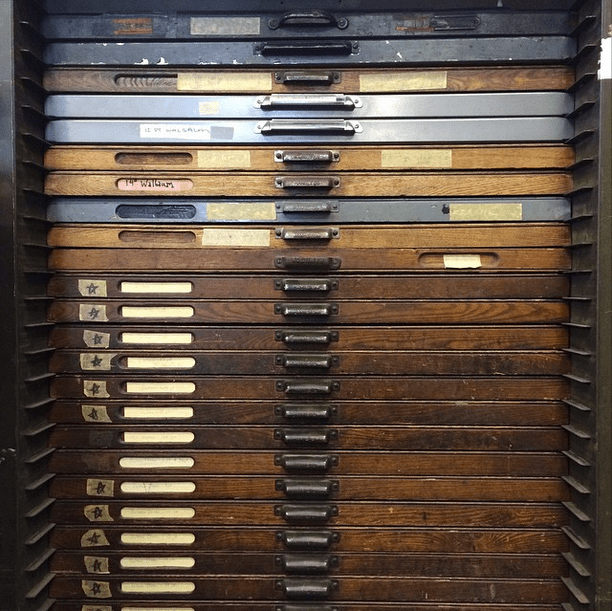 This old flat file is full of movable type, one of the many reminders in the office of our origin as a small letterpress operation. --@coffeehousepress