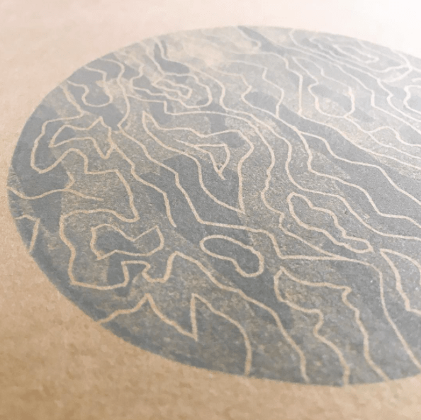 "Before & after: the linoleum & sticker paper from earlier this week have become this spooky, clouded tundra-moon (tundra-planet?) on the cover of Matthew Johnstone's ""Note on Tundra"""