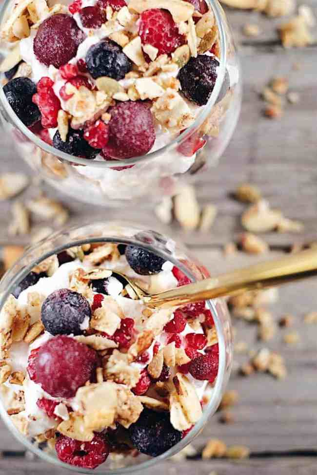 This creamy breakfast parfait is filled with healthy fats from the coconut milk, antioxidant rich berries and grain free granola to add a little crunch. Paleo, Gluten-Free, Grain-Free, Dairy-Free + Refined Sugar-Free. | realsimplegood.com