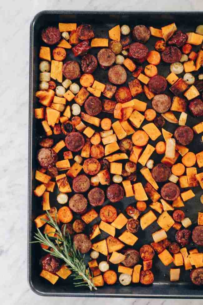 Whether you have an egg allergy or just want to mix things up, this Paleo and Whole30 Sheet Pan Roasted Sausage and Vegetables dish is for you! Squash, parsnips, carrots, sausage, greens and a creamy ranch. Paleo + Whole30 | realsimplegood.com