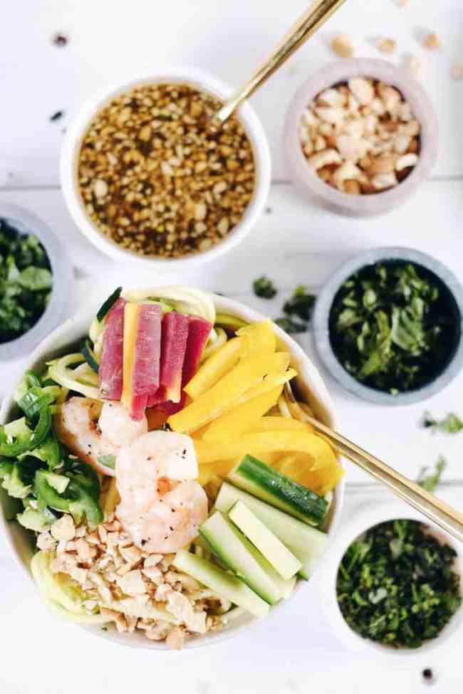 This shrimp zoodle spring roll bowl is packed with fresh and vibrant flavors and colors! It's light and refreshing, yet satisfying at the same time! Paleo, Whole30, Gluten-Free, Soy-Free + Dairy-Free. | realsimplegood.com
