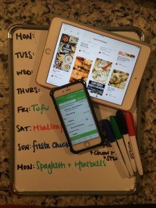 image of dry erase board, iphone with grocery iq app, and pinterest app on an ipad. real simple mama for family meal planning made real simple