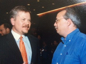 John Goff, left, of Crescent Real Estate, visits with Realty News Report editor Ralph Bivins at the grand opening of the 5 Houston Center building in 2002.