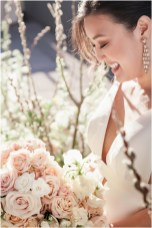 Gown from Second Summer Bride; Earrings by Deepa Gurnani; Bracelet by Mariell; Bouquet by Ames Haus Design with wholesale flowers from FiftyFlowers.com; Hair by Halo Salon & Day Spa; Makeup by Happily Beautiful Makeup Artistry & Skin Studio; Photography by 2 Girls 20 Cameras on location at Kimpton Sawyer Hotel.