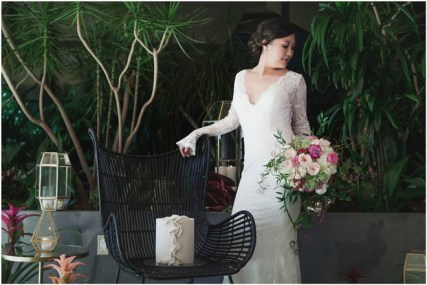Gown from The Bridal Box; Headpiece from USABride; Earrings from Macy's; Bouquet from Ambience Floral Design & Gifts; Hair by Halo Salon & Day Spa; Makeup by Happily Beautiful Makeup Artistry & Skin Studio; Photography by 2 Girls 20 Cameras on location at Kimpton Sawyer Hotel.
