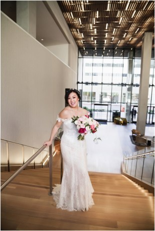 Gown from The Clothes Mine; Headpiece by Luxurious Bridal; Jewelry by Style Avenue Studios; Bouquet by Ambience Floral & Gifts; Hair by Halo Salon & Day Spa; Makeup by Happily Beautiful Makeup Artistry & Skin Studio; Photography by 2 Girls 20 Cameras on location at Kimpton Sawyer Hotel.