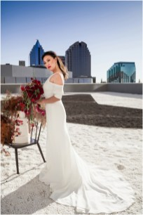 Gown from Always Elegant Bridal & Tuxedo; Earrings by Mariell; Bracelet from Macy's; Bouquet by Amour Florist & Bridal; Hair by Halo Salon & Day Spa; Makeup by Happily Beautiful Makeup Artistry & Skin Studio; Photography by 2 Girls 20 Cameras on location at Kimpton Sawyer Hotel.