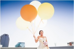Gown from Second Summer Bride; Jewelry by Sorrelli; Bouquet by Carson Valley Florist; Hair by Halo Salon & Day Spa; Makeup by Happily Beautiful Makeup Artistry & Skin Studio; Photography by 2 Girls 20 Cameras on location at Kimpton Sawyer Hotel. Balloons by The Party Concierge.