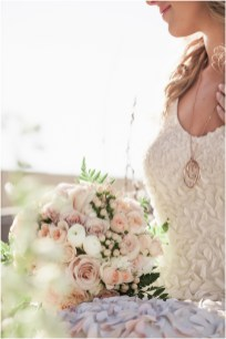 Gown from Second Summer Bride; Jewelry by Chloe + Isabel; Bouquet by Ames Haus Design with wholesale flowers from FiftyFlowers.com; Hair and makeup by All Dolled Up Hair and Makeup Artistry; Photo by 2 Girls 20 Cameras, on location at Kimpton Sawyer Hotel