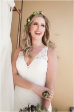 Gown from Second Summer Bride; Earrings by Sorrelli Jewelry; Floral crown, floral ring and bouquet by Strelitzia Flower Company; Hair and makeup by All Dolled Up Hair and Makeup Artistry; Photo by 2 Girls 20 Cameras, on location at Kimpton Sawyer Hotel