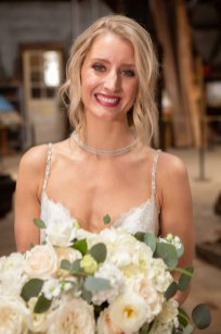 Gown from De La Rosa's Bridal & Tuxedos; Headpiece by Twigs & Honey; Earrings by USABride; Necklace from Macy's; Bouquet by Accents by Sage Floral Design; Hair by Lisa Harter Hair and Makeup Artist; Makeup by Happily Beautiful Makeup Artistry & Skin Studio. Photography by Farrell Photography on location at Hotel Sutter.