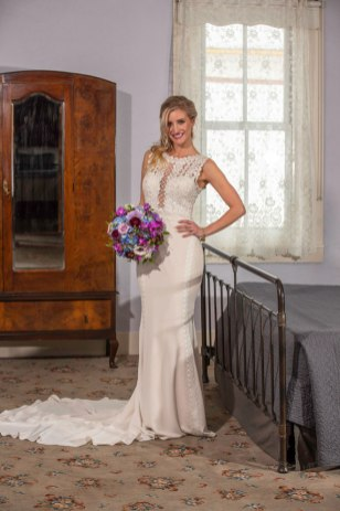 Gown from The Bridal Box; Jewelry from Macy's; Bouquet by Strelitzia Flower Company; Hair by Lisa Harter Hair and Makeup Artist; Makeup by Happily Beautiful Makeup Artistry & Skin Studio. Photography by Farrell Photography on location at Hotel Sutter.