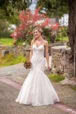 Gown from Always Elegant Bridal & Tuxedo; Jewelry from Macy's; Floral comb and bouquet by Carson Valley Florist; Hair by Lisa Harter Hair and Makeup Artist; Makeup by Happily Beautiful Makeup Artistry & Skin Studio. Photography by Farrell Photography on location at Hotel Sutter.