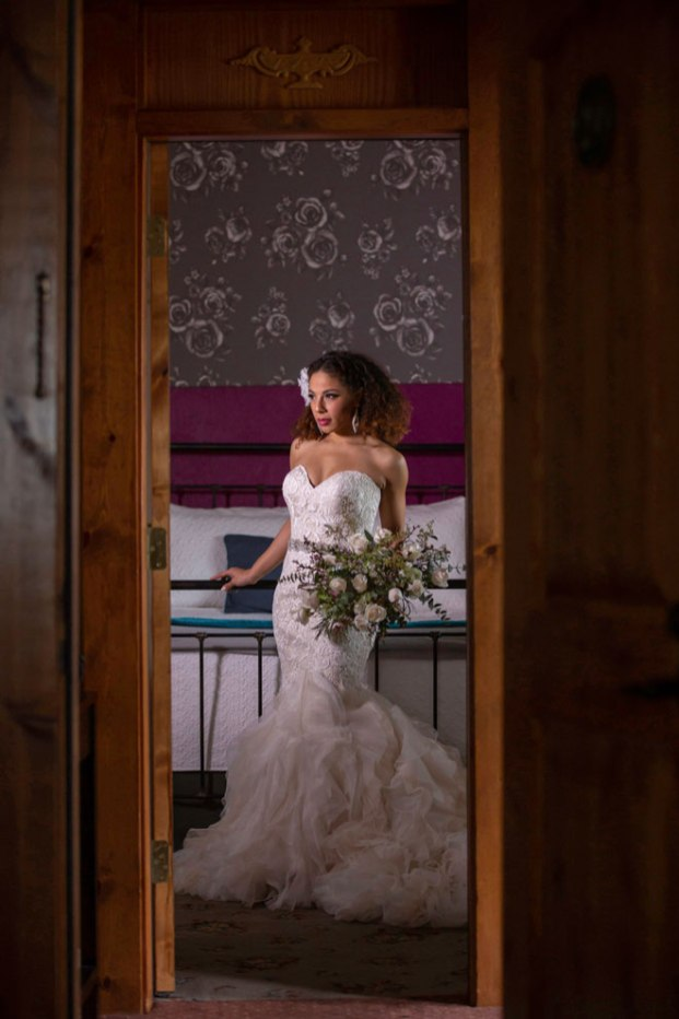 Gown from De la Rosa's Bridal & Tuxedos; Headpiece by Twigs & Honey; Earrings from Macy's; Belt by Luxurious Bridal; Bouquet by Carson Valley Florist; Hair and makeup by All Dolled Up Hair and Makeup Artistry; Photography by Farrell Photography on location at Hotel Sutter.