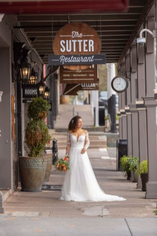 Gown from De la Rosa's Bridal & Tuxedos; Headpiece by Always Elegant Bridal & Tuxedo; Earrings from Macy's; Bouquet by Amour Florist & Bridal; Hair and makeup by All Dolled Up Hair and Makeup Artistry; Photography by Farrell Photography on location at Hotel Sutter.
