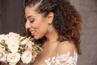 Gown from De la Rosa's Bridal & Tuxedos; Headpiece by Always Elegant Bridal & Tuxedo; Earrings from Macy's; Bouquet by Rodarte Floral Design; Hair and makeup by All Dolled Up Hair and Makeup Artistry; Photography by Farrell Photography on location at Hotel Sutter.