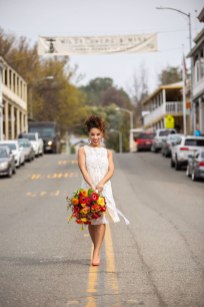 Gown from Second Summer Bride; Earrings from Macy's; Shoes from DSW; Bouquet by Paradise Parkway Event Productions; Hair and makeup by All Dolled Up Hair and Makeup Artistry; Photography by Farrell Photography on location at Hotel Sutter.
