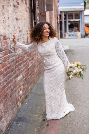 Gown from Always Elegant Bridal & Tuxedo; Earrings by Macy's; Boots by Ariat; Bouquet by Curious Floral; Hair and makeup by All Dolled Up Hair and Makeup Artistry; Photography by Farrell Photography on location at Hotel Sutter.