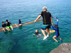 Jumping off the level 1 cliff before going for levels 2 and 3 (photo by Mike Apostol of Aroma Beach Station)