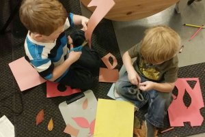 fall crafts with kids | tracing and cutting leaves from colored paper