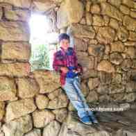 machu Picchu Evan stading on window