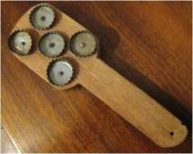 REAP teaches how to make a simple tool for removing scales from fish can be made by nailing bottle tops to a wooden paddle.