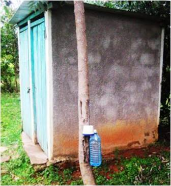A small hole in the bottom of a bottle enables the bottle to hold water for washing at home and outside the latrine
