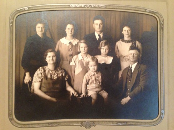 My Dad, standing male back row,  with his parents and siblings in the 1930s.