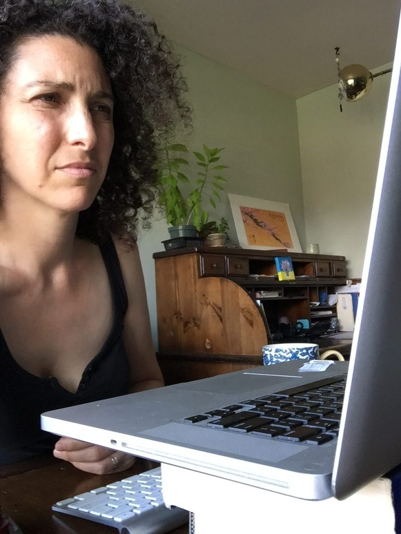 Rebecca Angel looking confused in front of a computer