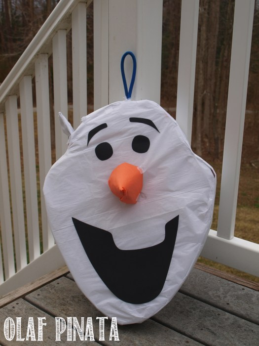 Handmade Olaf Pinata for a Frozen party theme. Enjoy the fun with breaking the pinata into pieces.