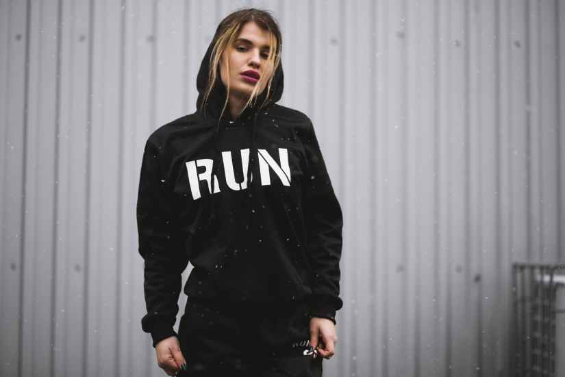 woman wearing black and white run printed pullover hoodie