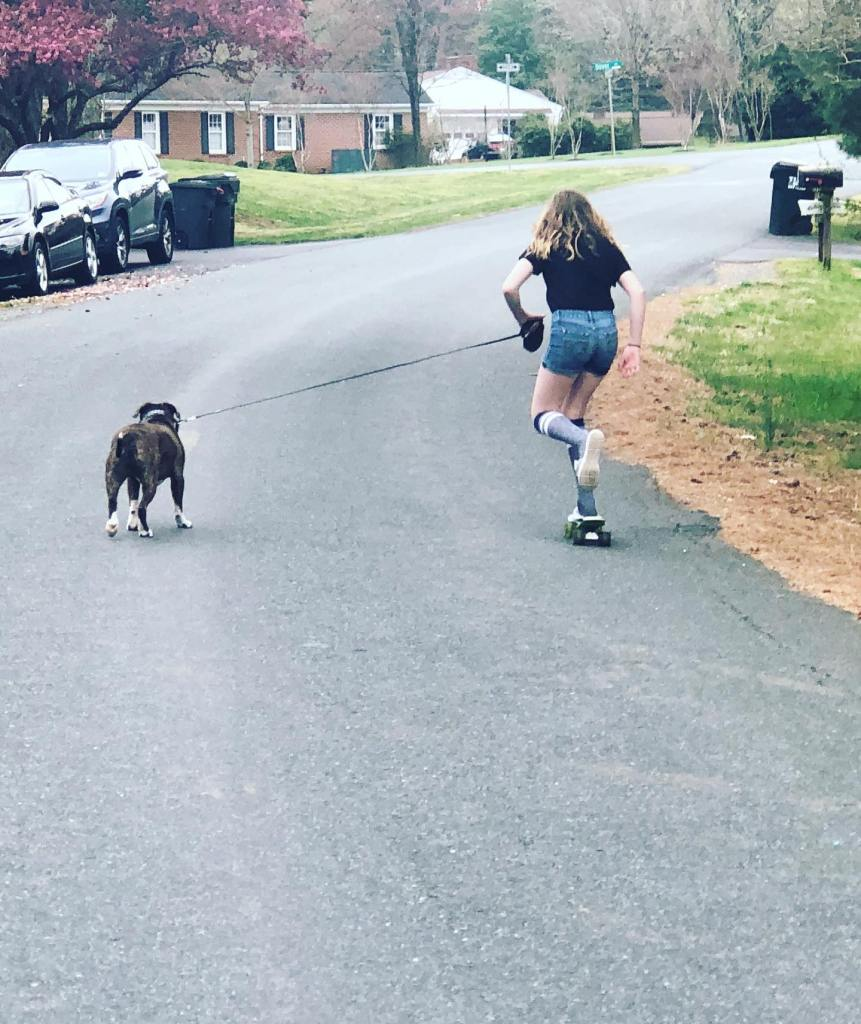 A skater girl and her dog